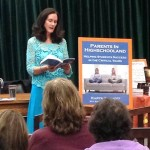 "Karyn reading from her book ""Parents in Highschooland."""